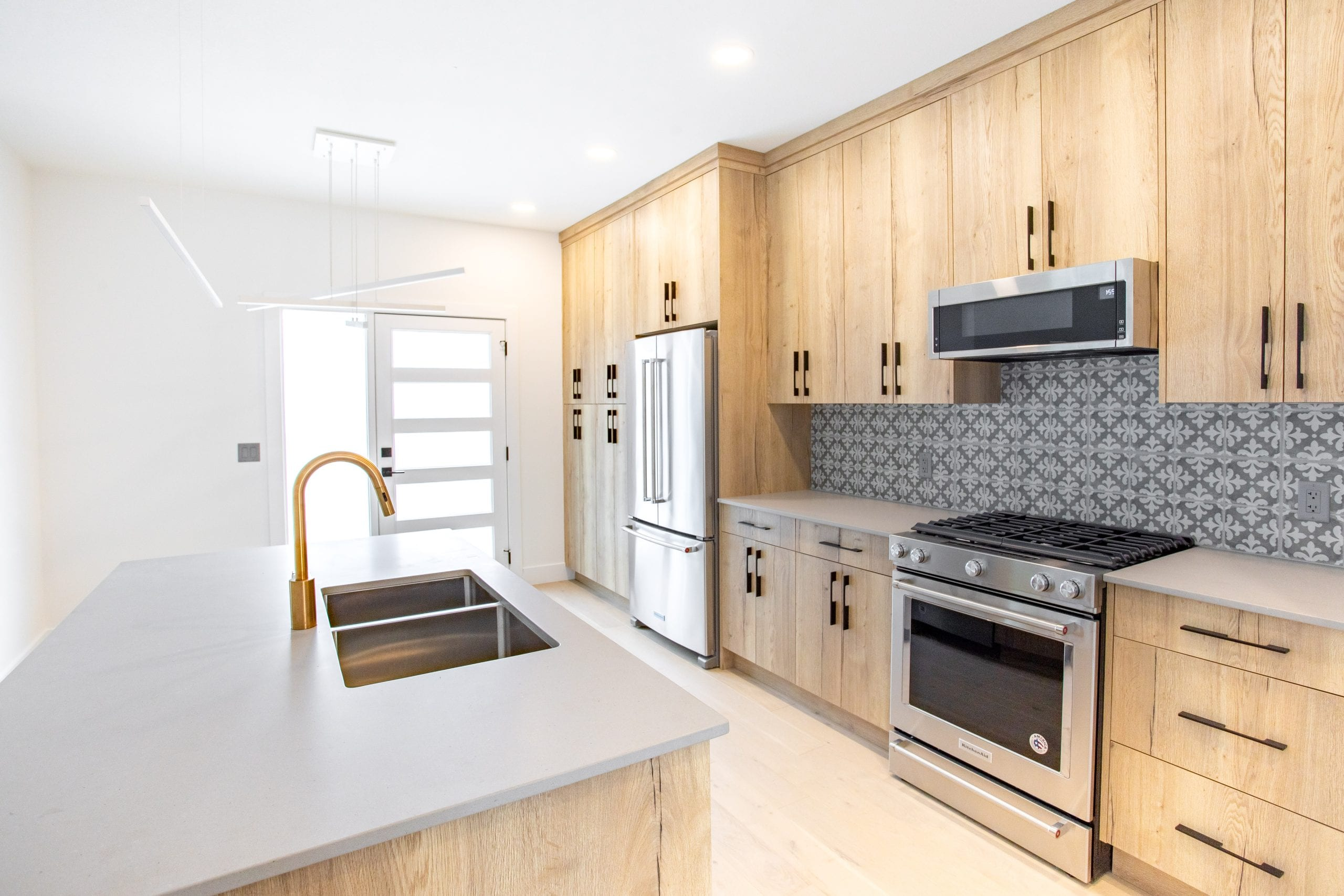 The Bay kitchen in Montauk colour palette with quartz, KitchenAid stainless steel appliances at The Landing at Wood Lake